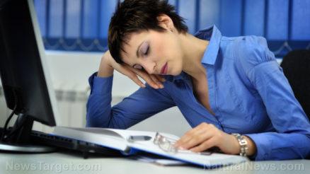 Woman-Asleep-Desk