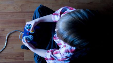 Top-View-Of-A-Boy-Playing-Video-Games-1