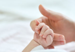 Holding Hands Mom And Newborn