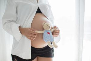 Pregnant Woman with teddy bear